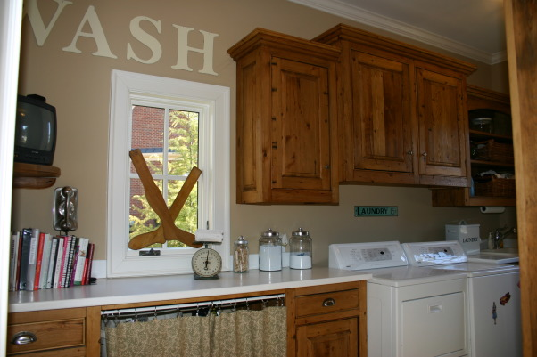 country casual laundry room, I love my laundry room because  it has so much storage.  We continued the reclaimed pine cabinets in here as well.   We did slate floors to break the space up., , Kitchens Design