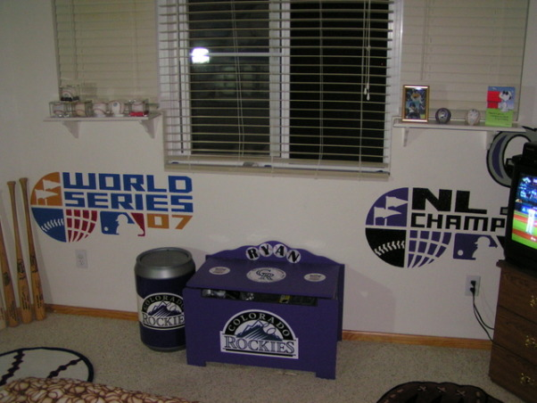 Colorado Rockies baseball room, I created this Colorado Rockies baseball bedroom for my 11 month old son but my 5 year-old  daughter liked it so much she has decided to trade him for a while.  , I hand-painted both of the 4 foot wide 2007 World Series logo and 2007 National League Champions logo.  Also the toy box that I converted from a Noah's Ark toy box to a Colorado Rockies toybox.  The big Rockies can on the left of the toy box is a laundry hamper., Boys' Rooms Design