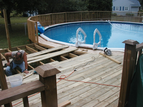 Deck leading to above ground pool, We connected the house deck to the pool deck.  Pictures that follow are of the process.  I will add the final pictures in the spring once the ugly pool cover is gone :), In the process of connecting the two decks., Pools Design