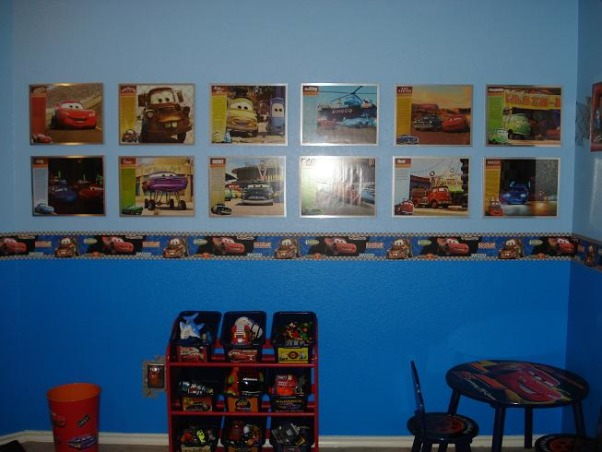 Cars Theme boy's room, My husband and I worked on the wall mural together the gas pump and sign has our last name and we used appliques for the cars driving along the road. The lake and lake island were created so we can name something after the kids. I made the window treatments and bed pillows. My husband created the light fixture silver floor clock and picture framed pieces. We went alittle overboard with the Cars theme but the boys love it!, My husband wanted a character gallery so he created customized picture frames by cutting apart two Cars calenders and framing it with nice silver metal frames. What you can't see in the picture is more Cars appliques above the pictures. We bought the Cars bed frame table and chairs and toy shelf bins as a set., Boys' Rooms Design