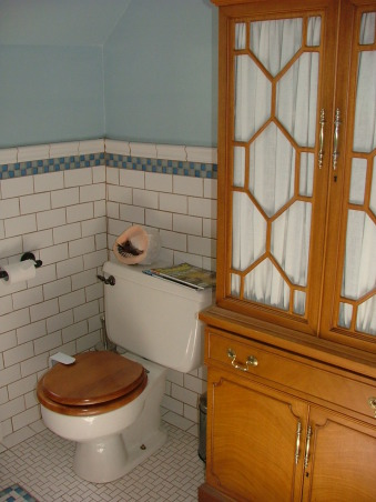 1905 Edwardian Master Bath, Our second bathroom re-do using existing second hand and overstock supplies and a lot of DIY!  This home was built in 1904 without bathrooms. Moved the plumbing around a bit and made this room into a 'period' bath for a family of four from a single-sink no-shower vinyl disaster! Total project was around $5K. All rooms will be updated but period-inspired due to the historical district trends/requirements of this neighborhood., This hutch is part of the set with the buffet (now a double sink). I think they are 1930s and are mahogany veneer.  We covered all of the wood in the room with boat varnish., Bathrooms Design