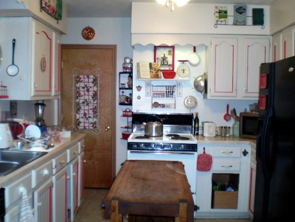 "My Retro 50's Vintage Red & White Kitchen, The basic white neutral kitchen...turned 1940's & 50's Red& White ""Blast from the past"". Fun and inviting! From cookbooks to utensils this kitchen really changes your mood! most itema were bought on ebay and at thrift stores. It is an ongoing project!, Kitchens Design"