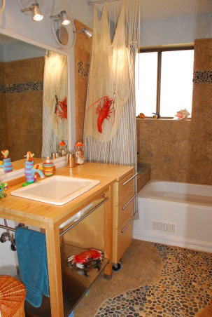 Beach Bathroom, Kids to tweens beach style bath with sandy tiles and river rock path. Washable wainscotting low towel hooks non-spinning TP holder & open sink base allows for stool to be tucked away. Wanted a boat sail for tub curtain but no luck finding 1!, Curly lights add interest for kids accessible hamper in Mom's interest!, Bathrooms Design
