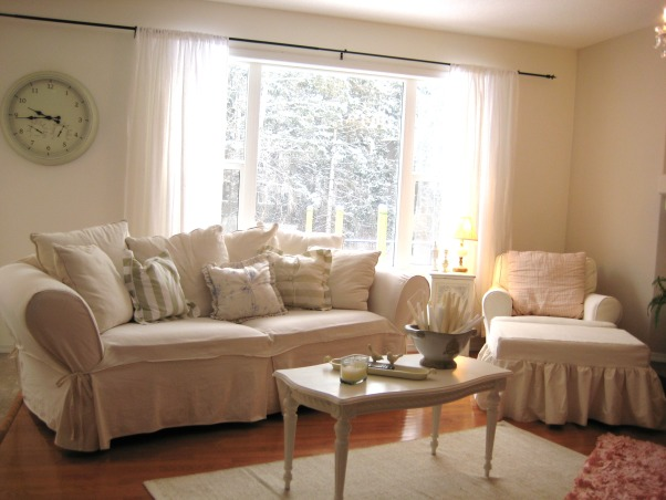 Shabby White Living Room, I like a mix of beach and cottage rooms. Because of the pups all the furniture is slipcovered  for easy cleaning. We collect antique astronomy books which is why we built the shelving on the fireplace to proudly display them. I am looking for  a nice fine moulding to finish the edges of the shelves still., Living Rooms Design