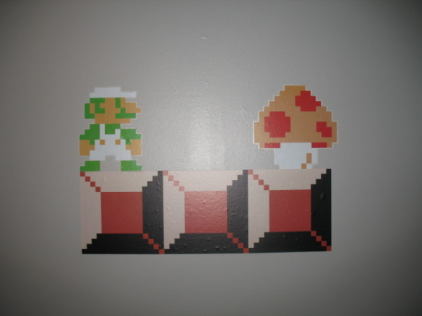Super Mario Brothers, Classic 80's Super Mario Brothers theme! Includes hand painted canvas of the last level of Super Mario Brothers a hand made quilt of a pixeled Mario and Super Mario wall decals! Lots of work and love!, Third wall with Super Mario Brothers decals, Nurseries Design