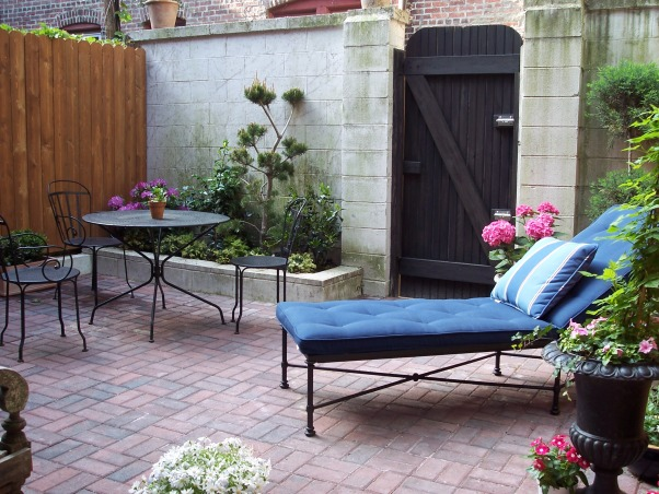 """Cute Courtyard from Old Trash Area, Outdoor space is at a premium in the city and we reclaimed this for use where trash cans used to reside and a rusted bike.  I did the brick in a weekend and left the distressed wall """"au natural"""", Outdoor Spaces"""