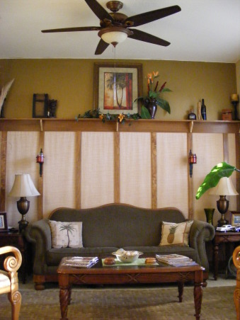 "Tropical Traveler Sitting Room, I love the tropics and wanted to create a room that embraced South Pacific/traditional decor with a hint of nostalgia.  Ok throw a bit of Craftsman style in there as well...I guess that is what truly makes this an eclectic space!  It was intended as a space that could evoke the feeling of arriving in an island destination somewhere off the beaten path in the 1940's.  This room is used for reading and listening to music on the new ""old"" mahogonay radio/cd player , , Living Rooms Design"