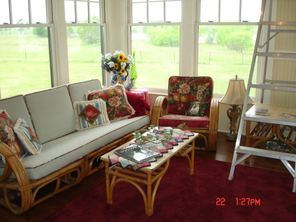 Sunroom Renovation, This is the sunroom off our Master Bedroom in the lakehouse, This is the rattan furniture my husband grew up with.  We had the cushions remade and reupholstered.  The red fabric is actually old curtains from a house we lived in 10 years ago!  My darling hubby suggested it since I loved the fabric so much and it was not being used anywhere!  Please excuse the ladder!, Porches Design