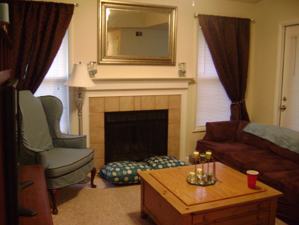 Chocolate and Blue, Welcome to my living room decorated with chocolate brown and a nice sky blue with green and silver accent colors. A couple of comfy couches and the best queen anne chairs you've ever seen., The fireplace and mantle area. We got a great deal on that mirror., Living Rooms Design