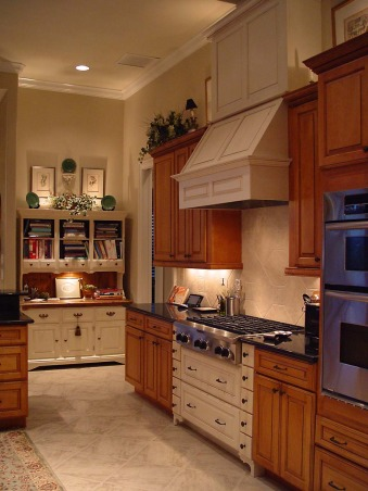 "Small but Efficient Kitchen, Thanks to HGTV Angelo & homeowner Andy for choosing my kitchen as an Inspiration Space on RMS the TV show! The galley-style kitchen is part of a big open concept living space. 12 ft. ceiling & tall range hood were a decorating challenge. Video tour and hutch refinishing how-to on my DIY blog at http://www.ratemyfavoritespaces.com. Thanks for stopping by! , The old pine hutch inspired the colors and finishes in the kitchen. It was dark and dated before I refinished it. See the ""before"" photo! , Kitchens Design"