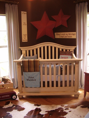 vintage/rustic baby boy room,  When i found out I was having a boy i knew it would be quite interesting to figure out how to REALLY decorate it with my flair...I had so much fun with it and am so happy with the way it turned out. I used so many textures( suede curtains cowhide rug and a real wood fence behind the clock) and even used my desk from my childhood as his changing table (after decoupaging painting and antiqueing it of course..lol.) Everything is customized all the bedding down to the lamp and table. Enjoy!, Nurseries Design