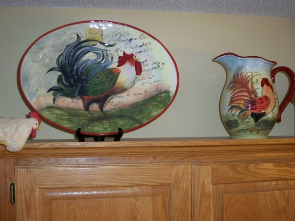 Forced to redecorate my kitchen, My old rooster rugs fell apart in the wash and I had seen these black ones on sale then the curtains were in close-out and then I found these cute reversible chair cushions.  What's a person to do?  Well redecorate of course!!!, close up of platter and pitcher, Kitchens Design