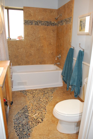 Beach Bathroom, Kids to tweens beach style bath with sandy tiles and river rock path. Washable wainscotting low towel hooks non-spinning TP holder & open sink base allows for stool to be tucked away. Wanted a boat sail for tub curtain but no luck finding 1!, Rock path adds whimsy  Gauguin  &  Cassat beach print reproductions add style., Bathrooms Design