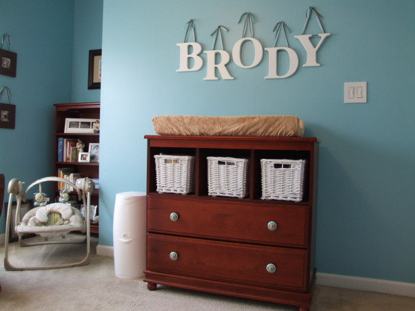 Brody's Room, This room decor was inspired by the prints of one of our favorite artists Stephen Huneck.  We have three dogs and hope that Brody is a dog lover too!, I changed out the knobs on the changing table with turquoise knobs with little doggie faces on them.  I actually found this idea on another Rate My Space posting and tracked down the lady who sells them on Ebay.  , Nurseries Design