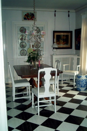a longer view of dining room, painted floor goes from dining room to sitting room, , Dining Rooms Design