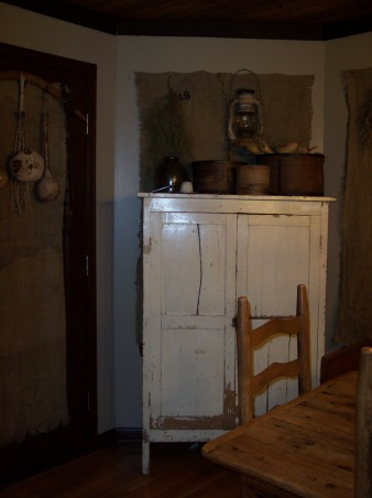 "Country Primitive Dining Room, Here are some pictures of our dining room. I know there is allot to look at...lol But this is the way we like it. I love all the old things....they give me such a ""homey"" feel. We just finished our ""remodel"" on the Dining Room about 6 months ago. Nothing needed to be done but to make this house our home this is what we have done....We add new fixtures boarding up the ceiling & painting the walls & trim. , This old Jelly Cabinet hides all of our kids ""art supplies"" what a perfect spot by the kitchen table. And it seems to keep those things somewhat organized.....and allows them to stay at the table instead of running around the house with markers....lol, Dining Rooms Design"