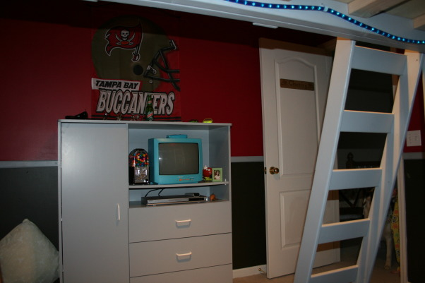 Bucs Room, Tampa Bay Theme Room with loft bed. Loft beds are quite pricing so my husband designed and contructed this full size loft which saved us about $300.00. We are in the process of constucting a Formica counter top for a desk to be installed soon! We were able to find sports team paint colors at The Home Depot. They offer all major league colors. We had fun with this room!, , Bedrooms Design