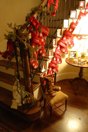 Deck them halls, ya'll! - Part 1, Decorating for Christmas means so much in our family. Our home becomes a living scrapbook of our 32 plus years of marriage many of which were lived overseas. From the German wax angel from one of our Kristkindle Markt visits to the ceramic angel on the tree given to me by my parents when I was six almost every piece has a history. So welcome to my English country Christmas in Texas!, We have so many children and grandchildren a single mantle simply won't do! So we used stocking hangers on the entry hall stairwell to cascade all the family stockings in one place. , Living Rooms Design