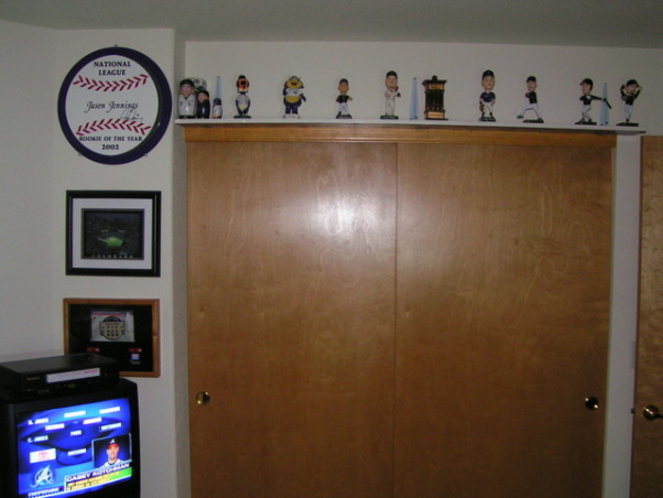 Colorado Rockies baseball room, I created this Colorado Rockies baseball bedroom for my 11 month old son but my 5 year-old  daughter liked it so much she has decided to trade him for a while.  , The shelf you see above the sliding closet doors is lined underneath with our actual season tickets from the Rockies games and the top is full of Colorado Rockies bobbleheads. , Boys' Rooms Design