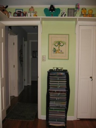 "Craft Room/Guest Room, This is a bedroom converted to my craft room with a ""hidden"" bed.  Used many trash-to-treasure ideas and handy husband., My scrapbook paper housed in this nifty storage unit with cute little retro needlepoint picture found on ebay for $6.  , Other Spaces Design"