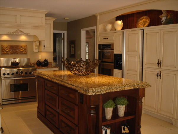 "HGTV RMS Inspiration Room - my new kitchen photos, My kitchen is one of the inspiration rooms on episode #208 of the Rate My Space Show. Thank you Angelo, Jillian and HGTV for choosing my kitchen as an inspiration room. It was quite an honor and a lot of fun being on the show. I renovated my kitchen a couple of years ago. We went from an outdated 1980's kitchen to this. The original kitchen had pickled oak cabinets with white formica countertops. I wish I had taken a ""before"" picture to show you. The change is remarkable., I used a double ogee edge on the island top. The ""bonnet"" over the pantry refrigerator and ovens has a stained cherry beadboard back to tie in with the island. It also helps to open up the space.          , Kitchens Design"