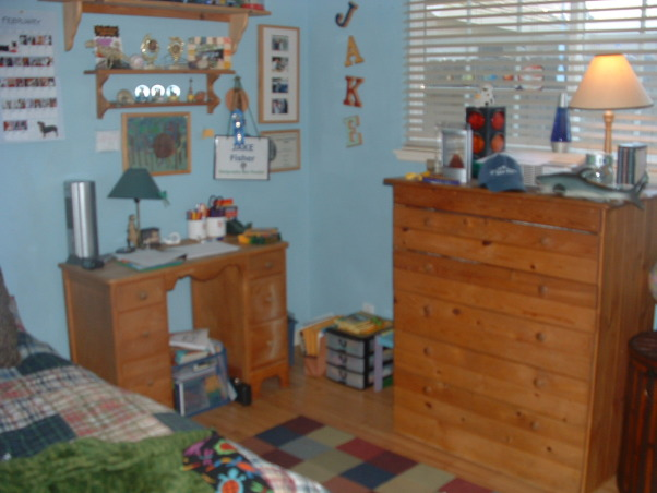 """Asperger bedroom makeover, My 12-year-old son has a form of autism called Asperger's Syndrome.  I felt that his old bedroom was too over stimulating for him so I did a mini-makeover to make it more serene and calm feeling.  He loves it.  His dad built the dresser when Jake was a baby so of course it has to stay.  The drawing is Jake's interpration of  """"The Scream.""""  The sword above the window is from his grandfather a captain in the Marine Corps (two tours in Vietnam).  It's a nice little room....very personal., Boys' Rooms Design"""