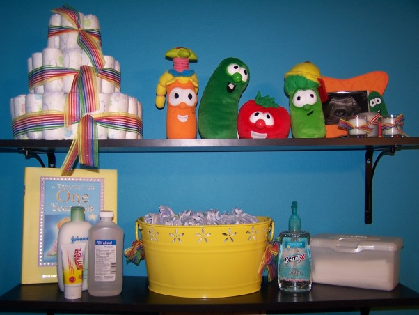 "Veggie Tales Nursery, First baby's nursery! We aren't finding out the sex of the baby until we meet him/her for the first time. We loved the idea of a ""christian"" themed nursery but aren't big fans of Noah's Ark decor so...Veggie Tales it is , Changing station shelves complete with pail of diapers germ-x lotion alcohol butt past a wipe warmer (not pictured here but in the other photo) and more colorful/veggie decorations, Nurseries Design"