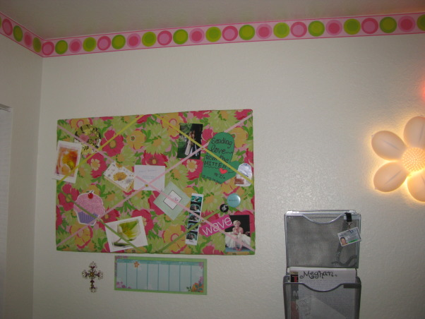 "A ""Vera Bradley"" Inspired Dorm Room, This is my first semester as a Junior at Florida Gulf Coast University in Ft. Myers FL. My boyfriend's granmother made me the most BEAUTIFUL quilt for my bed. I picked out all the patterns and wanted it to be similar to a Vera Bradley handbag. , I made the french memo board myself using fabric and ribbon from Joann's. , Dorm Rooms Design"