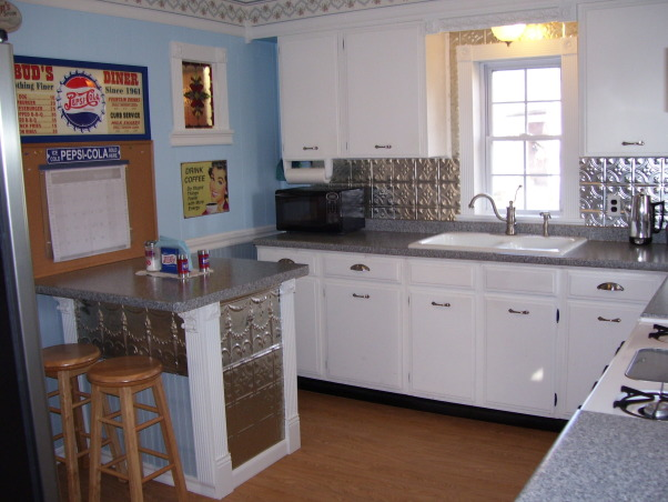 My Folk Victorian Kitchen Redo, Cost only about 2000 dollars for kitchen interior redo! Saved by using existing cabinets and appliances(appliances are newer) then added new hardware counters flooring lights window trim sink faucet plumbing wainscoting new breakfast bar built using existing leftover cabinet all new door and cabinet trim etc..  I tried to use trim to remind of an old victorian kitchen. I got very good deals off Ebay and did all the work myself.  , My Folk Victorian Kitchen Redo Breakfast Bar, Kitchens Design