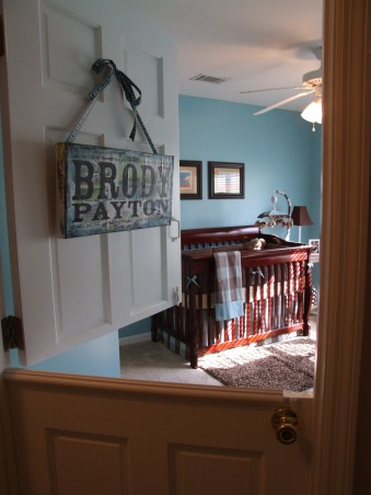 "Brody's Room, This room decor was inspired by the prints of one of our favorite artists Stephen Huneck.  We have three dogs and hope that Brody is a dog lover too!, After looking everywhere for a place that sold or could special order an interior dutch door my husband ended up making one himself.  Now we can keep the dogs out of the nursery but be able to look in on Brody in his room.The ""Brody Payton"" door hanging was custom made and used as decoration for one of my baby showers that my friends threw me.  , Nurseries Design"