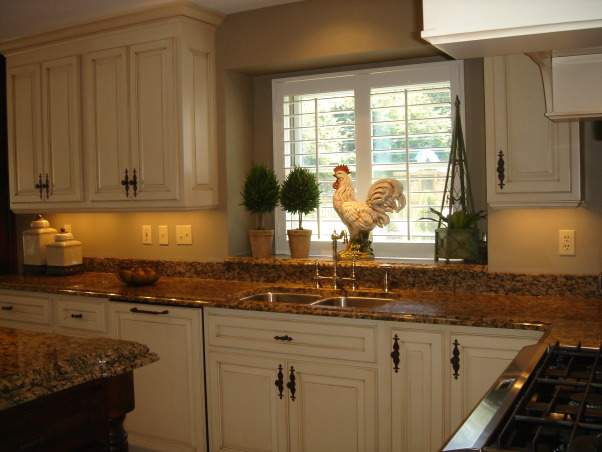 """HGTV RMS Inspiration Room - my new kitchen photos, My kitchen is one of the inspiration rooms on episode #208 of the Rate My Space Show. Thank you Angelo, Jillian and HGTV for choosing my kitchen as an inspiration room. It was quite an honor and a lot of fun being on the show. I renovated my kitchen a couple of years ago. We went from an outdated 1980's kitchen to this. The original kitchen had pickled oak cabinets with white formica countertops. I wish I had taken a """"before"""" picture to show you. The change is remarkable., Here is view of the sink area. I used hardware from Top Knobs. I believe I have 8 different styles of knobs in my kitchen but they are all a rusty patina finish.          , Kitchens Design"""