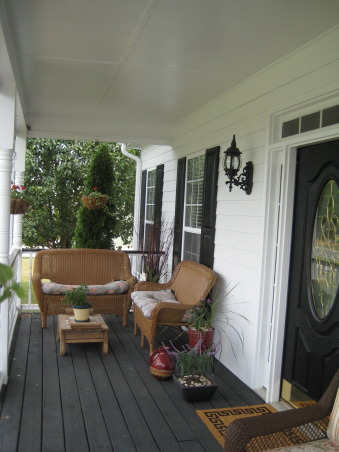 Front porch of our Cape Cod, Here is the front porch of our Cape Cod. It's a beautiful place to sit and watch thunderstorms roll in. Each new year we enjoy nesting Fork-Tailed-Swallows at the NW eve of this cute and cozy porch., , Porches Design