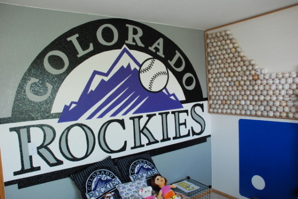 "Colorado Rockies baseball room, I created this Colorado Rockies baseball bedroom for my 11 month old son but my 5 year-old  daughter liked it so much she has decided to trade him for a while.  , I hand-painted this 10 foot wide Rockies logo and on the right you can see a part of my ""wall of balls""., Boys' Rooms Design"
