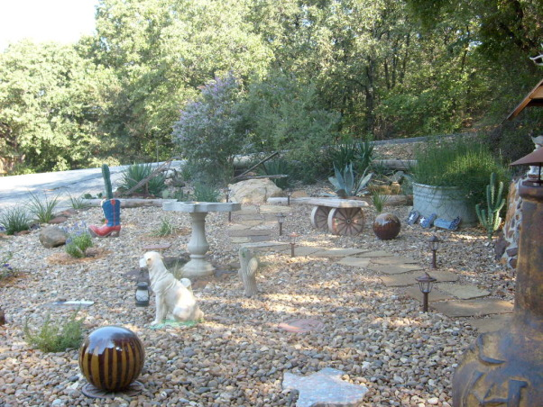 Texas  Pride  rock garden, we started out with the rock wishing welland outhouse and just keeps going!!My husband really did a great job it was 10 tons of rock, Winding stone path passes welltexas birdbath stone bench and horse troth full of horsetail reed ending at the Texas Sage. , Yards Design