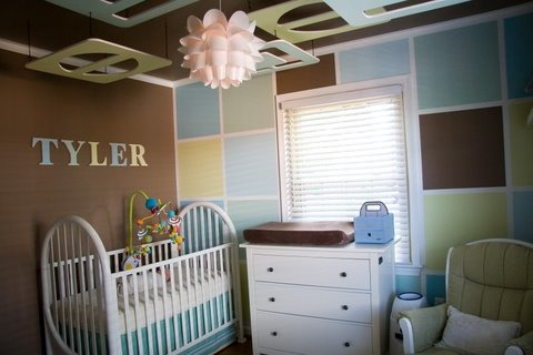 "Modern Baby Boy nursery on a Budget! , We wanted a Modern Boy nursery that looked design quality without the high designer cost.....our total cost including all supplies and furniture was under $800!  The ceiling pieces were cut from  5/8"" plywood and painted to match the block wall.  We gave the look of crown molding by taping and painting to create this illusion.  We were inspired by another design we found and improved upon it  to fit our own style and taste. We used no VOC paint throughout and organic bedding.  , This nursery was truely on a budget....crib was a hand me down from a friend ($0) light ($25)and dresser ($150) were from ikea glider (dutalier $150) was a craigslist bargain  the rug ($100) was from costco blinds ($50) from Lowes and floating shelf ($25) from home depot.  The no VOC paint wasn't cheap ($200) since 6 colors total were needed but the health benefits were well worth it! , Nurseries Design"