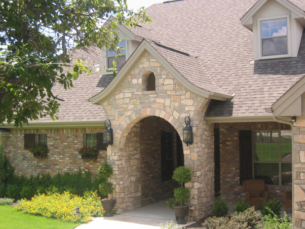 Stone and Brick Mix, I am not sure what style my home is considered to be but we were going for a European look. Hopefully it has that effect.  I think when the vine grows it will look more lush and cottage like., Home Exterior Design