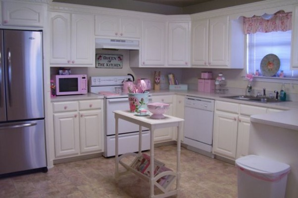 My Cottage Kitchen, This is my kitchen we painted the cabinets white they where finished in a light natural wood before we LOVE this look much better. Eventually we are going to get the matching stainless steel stove and dishwasher. I love pink & blue as you can tell :) I was hesitant to post these pics because this is a specific taste and not everyone likes girlie decorating.  But I LOVE my style and it's brings a big smile to my face when I come home =D ~~Jess , Later in the near future I will get the matching stainless steel stove and dishwasher and someday I will get my granite counter tops. I have a pink microwave pink toaster & a pink coffee maker that I LOVE soooo much =D, Kitchens Design