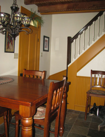 1800's Farmhouse Kitchen Makeover on a budget, A budget redo of an 1800's farm house kitchen. It was 70's retro complete with a yellow formica countertop and white linoleum floor. We wanted to bring a more primitive & period feel to the space., The original staircase is in the eating area we stripped off the carpeting to find very worn and damaged treads we added chocolate brown floor paint after patching bad areas and extended the pumpkin color on the trim going up the stairs., Kitchens Design