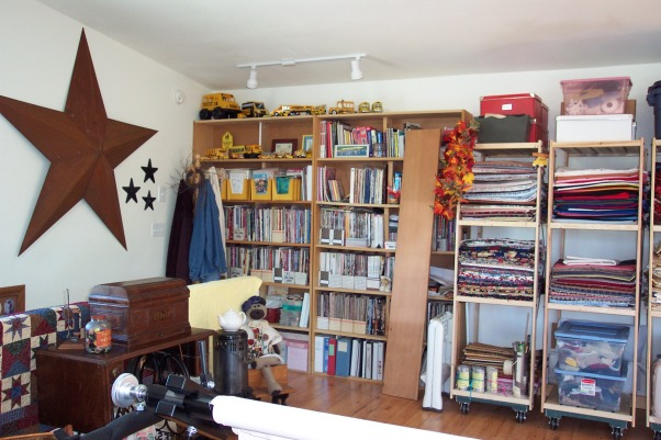 Dream Quilting Studio, Quilting/Sewing/Hobby Space, I have 8 feet of shelves for all my patterns. Easy accessability., Living Rooms Design