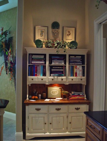 "Small but Efficient Kitchen, Thanks to HGTV Angelo & homeowner Andy for choosing my kitchen as an Inspiration Space on RMS the TV show! The galley-style kitchen is part of a big open concept living space. 12 ft. ceiling & tall range hood were a decorating challenge. Video tour and hutch refinishing how-to on my DIY blog at http://www.ratemyfavoritespaces.com. Thanks for stopping by! , The hutch was dark and dated when DH inherited it from his parents. I transformed it with creamy white paint. See ""BEFORE"" photo. Builder plan called for upper & lower cabinets but the space was PERFECT for this piece. Now we love it! , Kitchens Design"