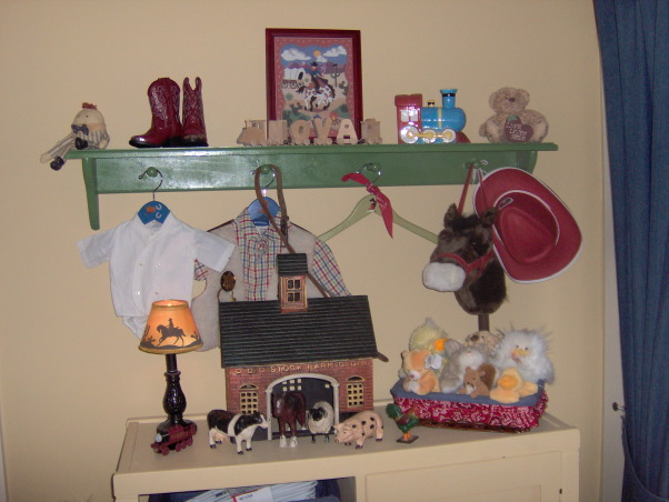 Cowboy Mix nursery/toddler room, Slowly adding vintage finds to complete the room.  I still have a lot of stuff to hang up!  Going mostly with cowboys but also trains Americana old toys and a few other things as well.  Pretty much everything was from ebay or yard sales or dumpster diving., Still need to paint his name train.  Baptism outfit was my husband's cowboy vest was my dad's., Boys' Rooms Design