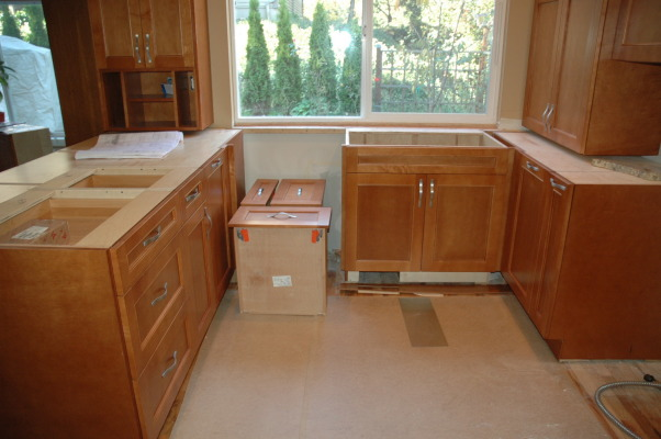 Compact Kitchen, Utilizing existing confined space to pack in a lot of features and function., Setting cabinetry for countertop to extend into window.  , Kitchens