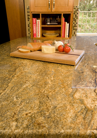 Compact Kitchen, Utilizing existing confined space to pack in a lot of features and function., Homeowner liked glass tiles and found granite with similar color tones to match.  , Kitchens