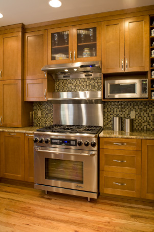 Compact Kitchen, Utilizing existing confined space to pack in a lot of features and function., Small upper left of range for spices.  Shelf-set microwave makes way for future upgrading   , Kitchens