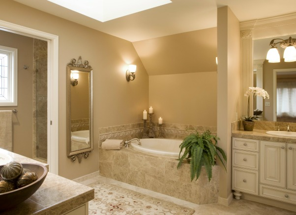 Bellagio Inspired Master, Updating master bath utilizing existing fixture locations.  Goal of improvements to fulfill customer's experience in the Bellagio Las Vegas Hotel., A new skylight brightens the marble and Antique Creme painted cabinetry., Bathrooms