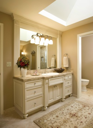 Bellagio Inspired Master, Updating master bath utilizing existing fixture locations.  Goal of improvements to fulfill customer's experience in the Bellagio Las Vegas Hotel., Fluted columns and ornamental applique frames the mirror and sink basin., Bathrooms