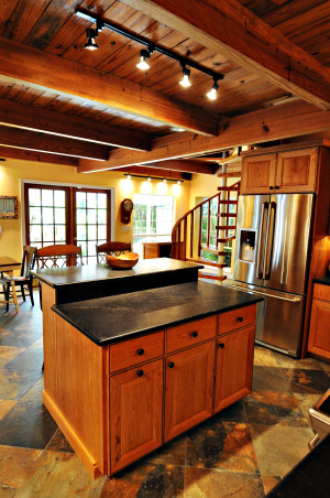 From dysfunctional to functional and beautiful, Our coastal 1925 cottage had been added onto several times.  Unfortunately the kitchen  was pieced together with shotty workmanship and bits and pieces of left over materials.  The entire floor structure, electrical,  plumbing and windows had to be replaced which added quite a bit to our estimated costs.  4 months later we have a warm, cozy, rustic space with just enough modern appeal.  Truly a place now to gather with family and friends.  On to the next project......, I fell in love with soapstone counter tops a few years ago but with an active family we decided they just may not be very practical.  Low and behold we stumbled onto Absolute black, honed leather granite.  Looks and feels VERY similar to soapstone yet it's hard as....a rock!!!! Love, love, love it!!!!! , Kitchens