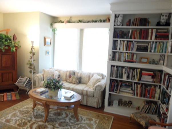 Booklovers Library and Parlor, We wanted to create a booklovers haven with a Southern Garden theme. , We found a sofa that fit just right into the bay window area, giving more room to the small space.    , Living Spaces