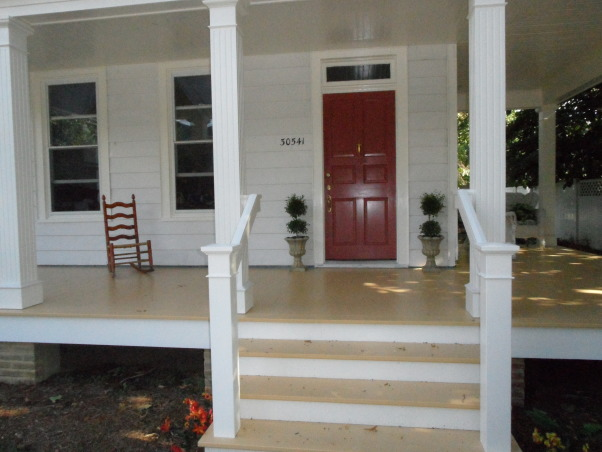 Greek Revival front porch, The porch and columns were rotten and had to be completely demolished and rebuilt, including digging down and pouring new footings. Peter did all the work himself in about nine months while working a full time job.  He watched  youtube how to videos on brick laying and did the brick work on the front of the new footings. He took the old columns, repaired the rotted areas, rerouted them and added details to the top and bottom. The decking was hand cut from treated lumber to look like a traditional wood porch.  He completed the look with a grand staircase fitting with the style of the porch and house.  Using a professional grade paint sprayer helped give it a clean look and made it easier for him to finish the project. , Home Exteriors