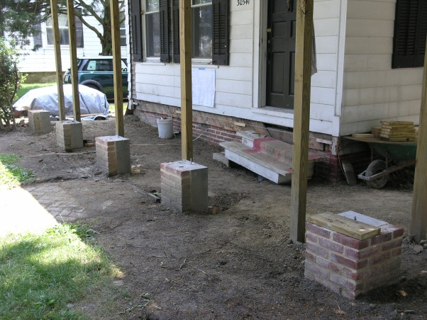 Greek Revival front porch, The porch and columns were rotten and had to be completely demolished and rebuilt, including digging down and pouring new footings. Peter did all the work himself in about nine months while working a full time job.  He watched  youtube how to videos on brick laying and did the brick work on the front of the new footings. He took the old columns, repaired the rotted areas, rerouted them and added details to the top and bottom. The decking was hand cut from treated lumber to look like a traditional wood porch.  He completed the look with a grand staircase fitting with the style of the porch and house.  Using a professional grade paint sprayer helped give it a clean look and made it easier for him to finish the project. , Peter watched videos of brick laying to learn how to put brick on the front of the footings.      , Home Exteriors